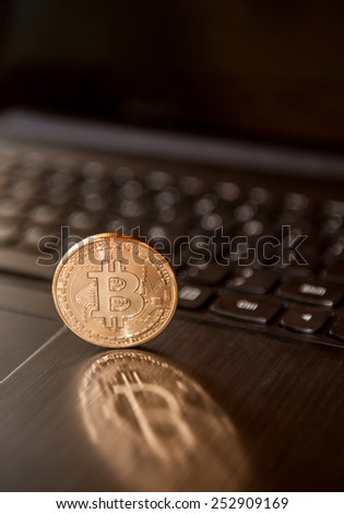 Close up of bitcoin symbol on black keyboard - stock photo