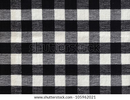 Close-up of black and white gingham checked fabric background - stock photo