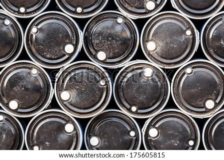 close up of black color oil barrels - stock photo