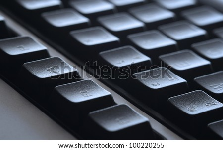 Close up of black keyboard with selective focus. - stock photo