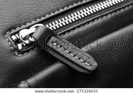 Close up of black leather bag zipper, black leather bag close up - stock photo
