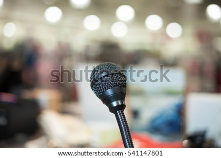 Close up of black microphone at huge conference hall
