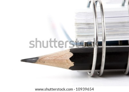 close up of black pencil and notebook - stock photo
