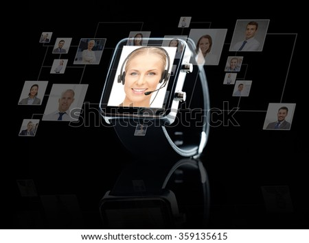 close up of black smart watch with contacts online - stock photo