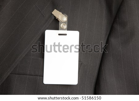 close up of black suit with id card - stock photo