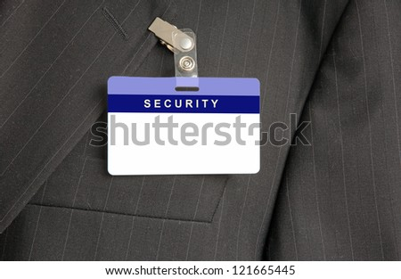 Close Up of Black Suit with Security ID Card - stock photo