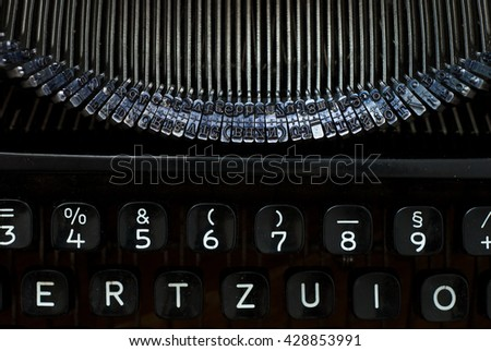 close up of black typewriter - studio shot from above - natural light - vintage object