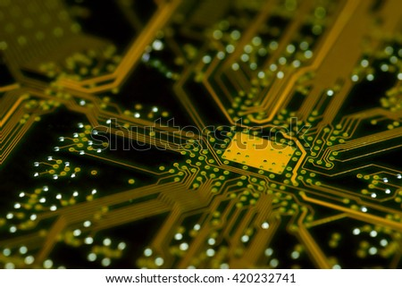 close-up of black yellow pcb motherboard with chip  - stock photo