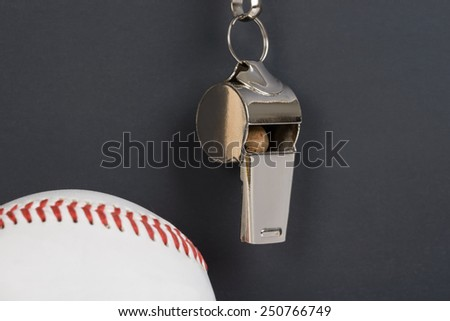 Close-up Of Blackboard With Baseball And Sport Whistle - stock photo