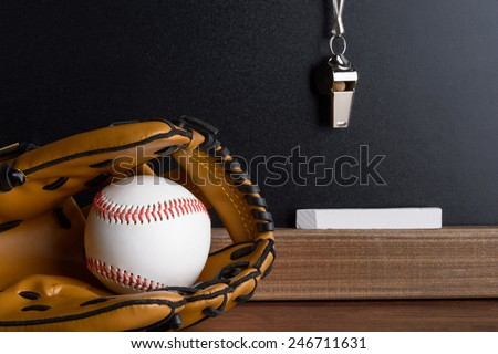 Close-up Of Blackboard With Baseball; Sport Whistle; Chalk And Leather Gloves - stock photo