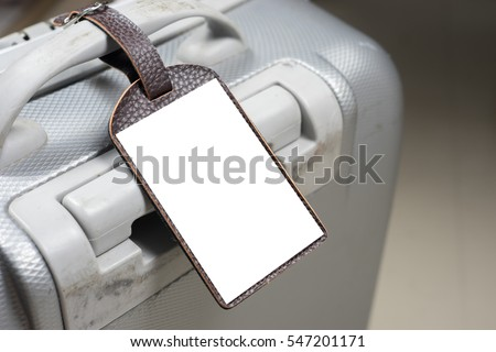 Close up of blank Leather luggage tag label on oid suitcase or bag with TRAVEL INSURANCE ,Can be used for montage or display your products,selective focus,vintage color