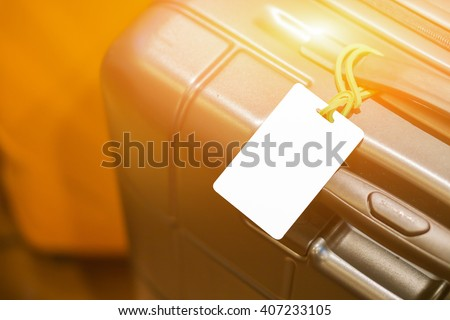 Close up of blank luggage tag on suitcase,luggage label,tag on luggage,Suitcase with TRAVEL INSURANCE label,selective focus,vintage color - stock photo