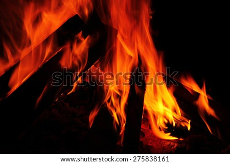 Close up of blazing fire. with black background - stock photo