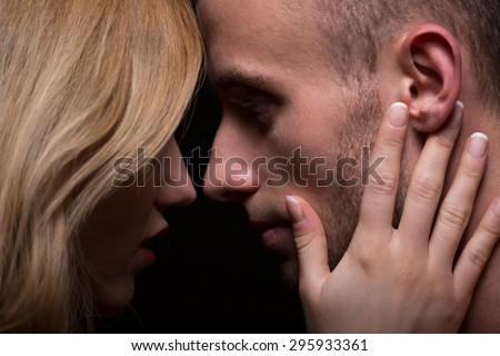 Close-up of blond woman touching her boyfriend's face