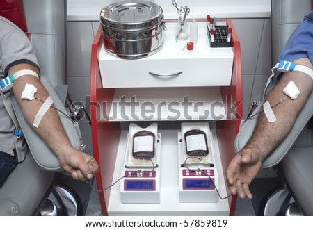 close up of blood extraction in lab - stock photo