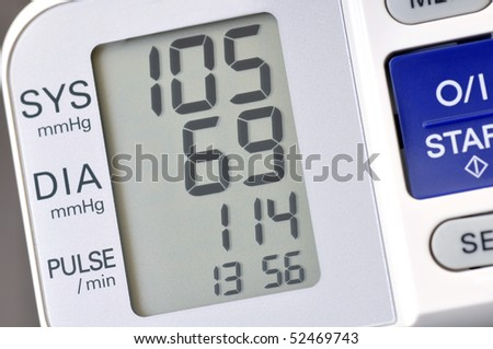 Close up of blood pressure monitor showing recent reading - stock photo