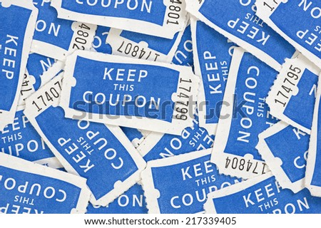 close up of blue and white keep this coupon numbered raffle tickets background - stock photo
