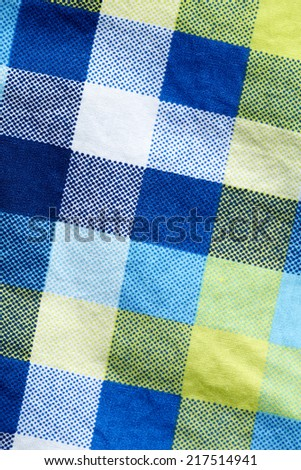 Close up of blue and yellow check material  - stock photo