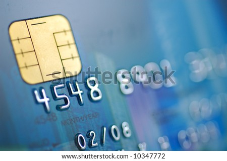 Close up of blue credit card with chip (shallow DOF) - stock photo