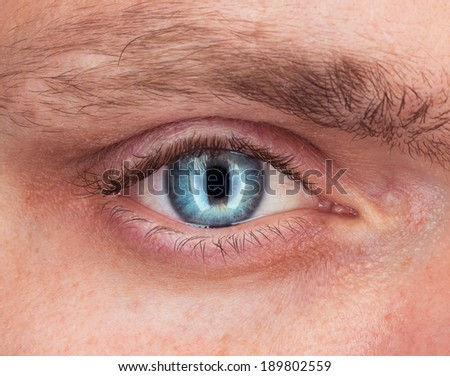 Close-up of blue eye a young man - stock photo