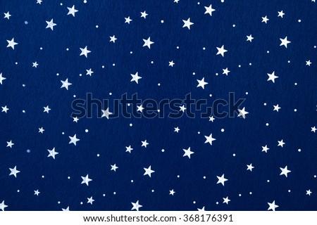 Close-up of blue felt with stars background. - stock photo