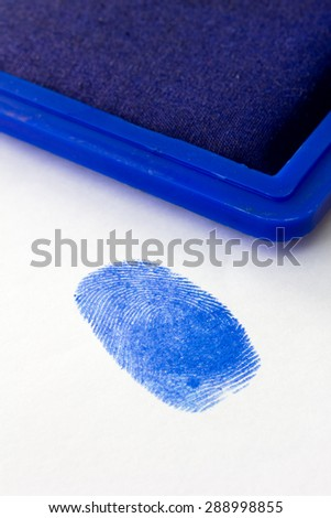 close up of blue fingerprint - stock photo