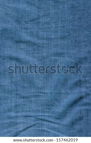Close-up of blue folded denim texture - stock photo