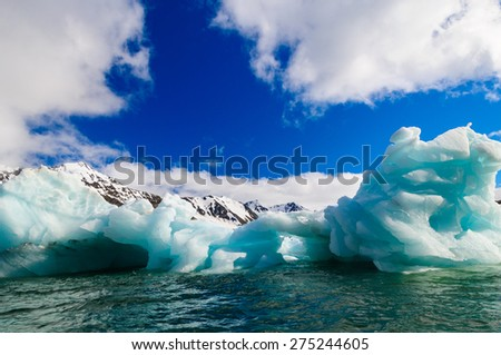 Close up of blue green icebergs floating in a fjord in Hornsund, Svalbard, Norway.