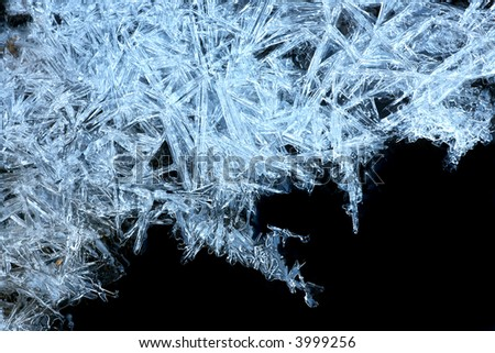 close up of blue ice crystals forming spiky ornaments - stock photo