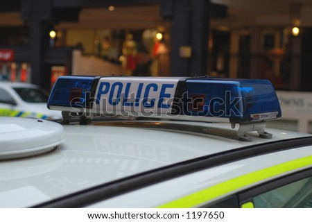Close up of blue lights on top of a UK police car. - stock photo