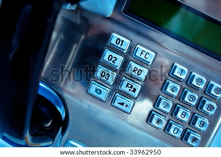 Close-up of blue metal telephone - stock photo