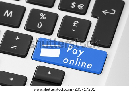 Close up of blue pay online button on keyboard with credit card symbol - stock photo