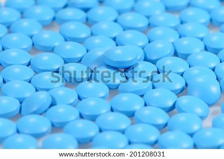close up of  blue pills  - stock photo