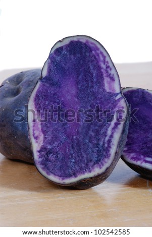 Close up of blue potatoes, sliced in half - stock photo