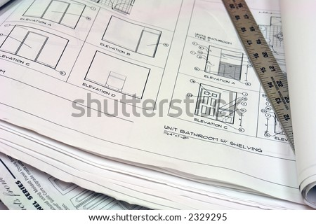 close up of blue prints with metal ruler