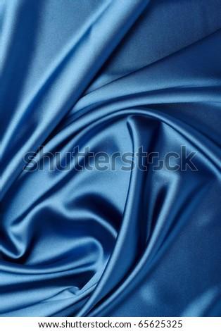 close up of blue silk textured cloth - stock photo