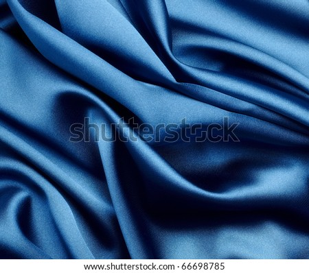 close up of blue silk textured cloth - stock photo