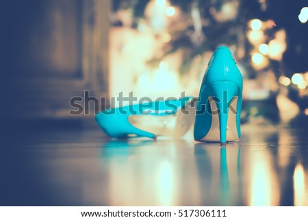 close-up of blue / turquoise party shoes with golden bottom. Selective focus.