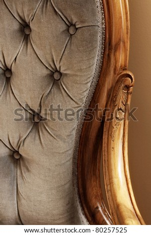 close up of blue velvet chair with wooden arms - stock photo