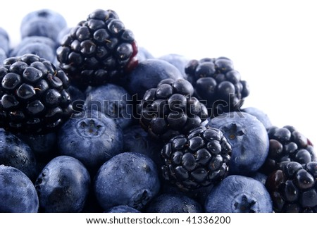 Close up of blueberries and blackberries in a pile