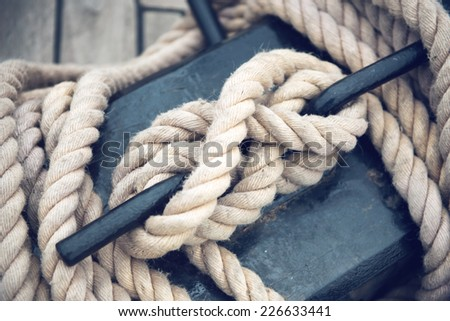 Close Up of Boat Rope Tied on Figure Eight Cleat Hitch - stock photo