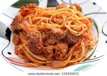 Close up of bolognese pasta in plate over white background. - stock photo