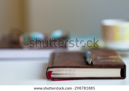 Close up of book blurred with very shallow depth of field (soft focus)  - stock photo
