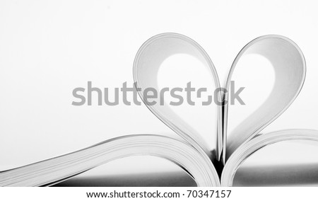 Close-up of book pages folded into a heart shape - stock photo