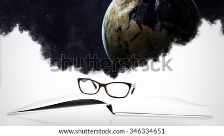 Close up of book with space objects. Elements furnished by NASA - stock photo