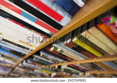 close up of books in book shelf in library - stock photo