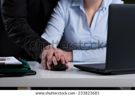 Close-up of boss mobbing his employee at work - stock photo