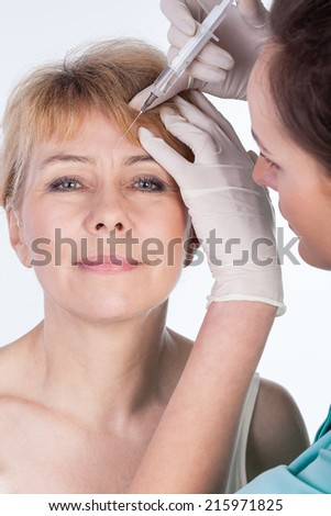 Close-up of botox injected in a forehead - stock photo