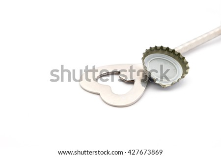 close up of bottle opener and cap on white background with clipping path  - stock photo