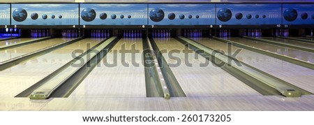 Close up of bowling balls, bowling pins bowling balls in a row  - stock photo